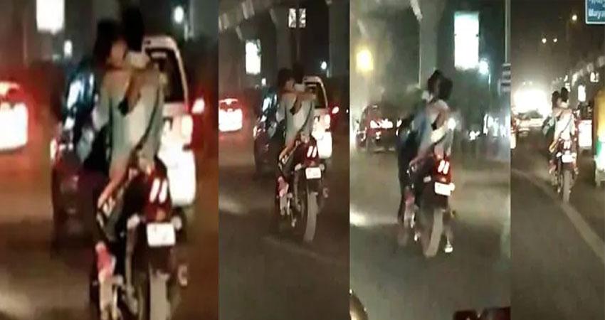 चलती बाइक के फ्यूल टैंक पर बैठकर फिल्मी अंदाज में किस करता नजर आया ये कपल, Video वायरल