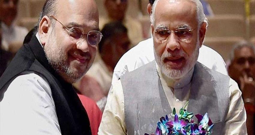 पीएम मोदी के CM से लेकर PM तक के सफर पर अमित शाह ने साधा विपक्ष पर निशाना